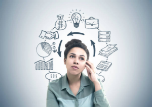 Young woman with a thoughtful expression on her face and business graphics in the background representing her thoughts.
