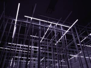 Futuristic metal frames inside a warehouse.